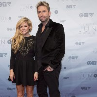 Chad Kroeger and Avril Lavigne arrive on the red carpet at the Juno Awards in Calgary, Sunday, April 3, 2016. THE CANADIAN PRESS/Jeff McIntosh